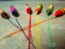 Six Crayons on Gray Concrete Floor Royalty Free Stock Image
