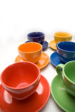 Six cups. Six color cups on the background royalty free stock photo