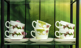 Six cups on a shelf Royalty Free Stock Photos