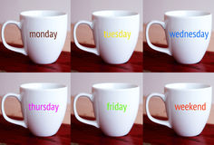 Six cups with the words of the week and weekend Royalty Free Stock Photography