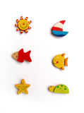 Six cute fridge magnets. A cute design collection of 6 brightly coloured fridge magnet, on a Sunny Beach theme. Magnets are made of wood and painted in bright royalty free stock image