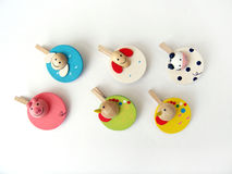 Six cute paper clips. Six cute design bright and colourful wooden paper clips, made into the shapes of animals. Fun stationery for children. Taken on clean white royalty free stock photo