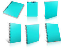 Six cyan spiral blank notepad on white. Stock Photography