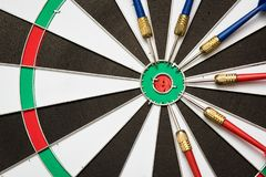 Dartboard. Six darts on the target center of dartboard Royalty Free Stock Images