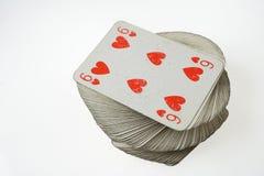 Six de coeurs en haut de jouer le paquet de cartes Photographie stock