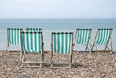 Six Deckchairs Facing Sea Royalty Free Stock Image