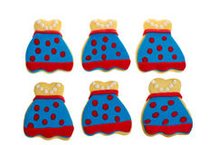 Six decorated apron cookies red on blue Stock Photos