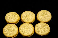 Six deluxe sweet round cookie`s. A cookie is a baked or cooked food that is small, flat and sweet. It usually contains flour, sugar and some type of oil or fat Stock Photo