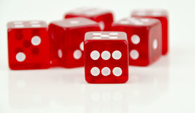 Six dice with closeup on number six Royalty Free Stock Image