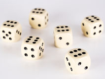 Six dice with six. On a white surface Royalty Free Stock Image