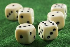 Six dices on a green table Royalty Free Stock Photos