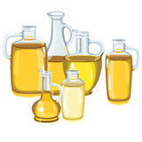 Six different glass bottles with oil in them Royalty Free Stock Photography