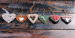 Six different  hearts on shabby background Stock Images