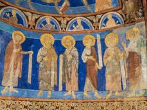 Six disciples with texts in a medieval wall-painting. A romanesque mural in Bjaresjo church, Sweden, November 6, 2009 Stock Photo