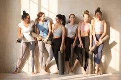 Six diverse sporty girls holding yoga mat ready start training stock image