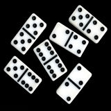 Six Dominoes on a black background Royalty Free Stock Photography