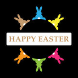Six Easter bunnies in different colors with text. Six Easter bunnies in different colors in a circle and text on a black background Stock Photos