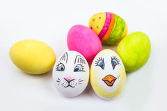 Six Easter eggs in different colors and designs. Several painted eggs, some with motives of a chicken and an Easter bunny Royalty Free Stock Images
