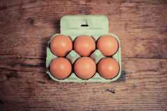 Six eggs in a cardboard tray Stock Photography