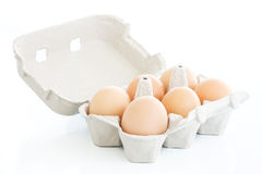 Six eggs on a carton box over white Royalty Free Stock Image
