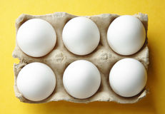 Six Eggs in an Open Carton Stock Images