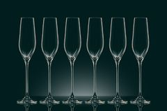 Six empty clean glasses. On black Royalty Free Stock Photography