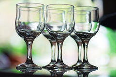 Six empty crystal wine glasses Stock Photo