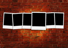 Six Empty Polaroids on Red Brick Wall Stock Images