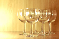 Six empty wine glasses. On a wooden background Stock Photos