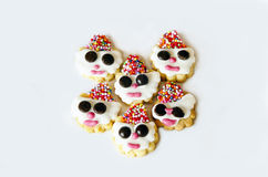 Six face cookies. Cookies with face wearing hat on white background Royalty Free Stock Image