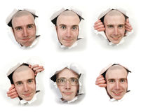 Six faces looking through holes Royalty Free Stock Photography