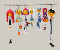 Six female and one male handmade isolated thin dolls toys in fas Royalty Free Stock Image