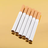 Six filter cigarettes. On the golden background Stock Photo