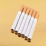 Six filter cigarettes Stock Photo