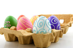 Six folorful easter eggs in box. Isolated on white background stock photo