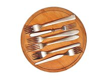 Six forks on breadboard Stock Image