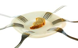 Six forks and a crust of a bread. Isolated on a white background Stock Image