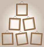 Six frames on wall on brown Royalty Free Stock Photo
