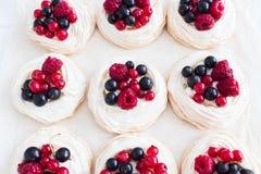 Six fresh trendy mini pavlova cake. stock photos