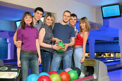 Six friends stand near stand ruling balls Royalty Free Stock Images
