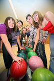 Six friends are taken by balls in bowling club stock photos