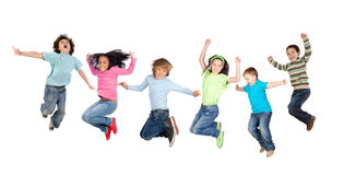 Six funny children jumping royalty free stock image