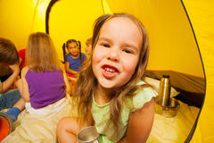 Six funny kids are sitting in a tent Stock Image
