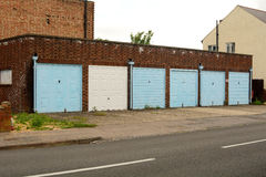 Six garages in a block Royalty Free Stock Photos
