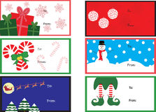 Six Gift tags. Six Christmas gift tags, with presents, baubles, candy canes, snowman, Santa, his and his reindeer and elf Stock Images
