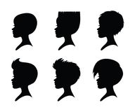 A set of girls silhouettes with short haircuts. Six girl heads. Short hairstyles. Black silhouettes isolated on a white background. Vector Royalty Free Stock Photo
