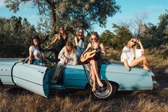 Six girls have fun in the countryside. Six girls have fun on the car in the countryside Royalty Free Stock Image