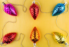 Six glass Christmas fir cones on golden background Stock Images