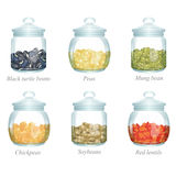 Six glass jars with beans and peas in them Royalty Free Stock Image