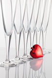 Six glasses of champagne and red heart Royalty Free Stock Photography